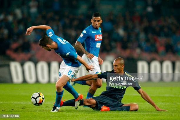Inter Milan's Brazilian defender Miranda fights for the ball with Napoli's Italian midfielder Brazilianborn Jorginho next to Napoli's Brazilian...