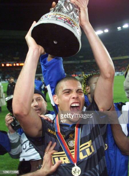 Inter Milan's Brazilian forward Ronaldo holds his trophy aloft after his team beat Lazio Rome 30 06 May at the Parc des Princes Stadium in Paris...