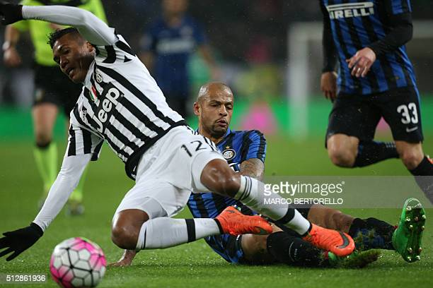 Inter Milan's Brazilian midfielder Felipe Melo vies with Juventus' Brazilian defender Alex Sandro during the Italian Serie A football match Juventus...