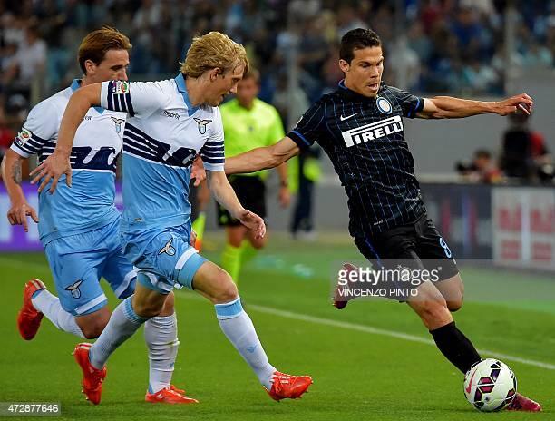 Inter Milan's Brazilian midfielder Hernanes vies with Lazio's Serbian defender Dusan Basta during their Italian Serie A football match Lazio vs...