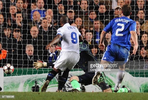 Inter Milan's Cameroonian forward Samuel Eto'o scores past Chelsea's goalkeeper Ross Turnbull as Chelsea's defender Branislav Ivanovic looks on...