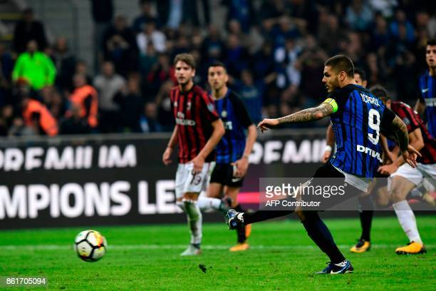 Inter Milan's Captain Argentinian forward Mauro Icardi kicks and score a penalty during the Italian Serie A football match Inter Milan Vs AC Milan on...