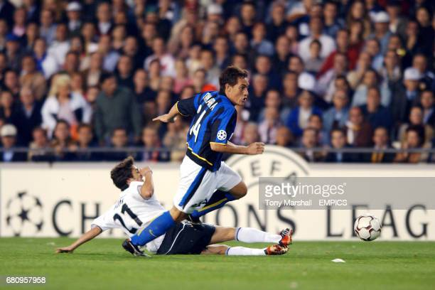 Inter Milan's Carlos Gamarra skips the challenge of Valencia's Pablo Aimar
