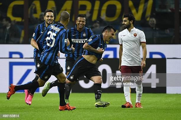 Inter Milan's Chilean midfielder Gary Medel celebrates after scoring during the Italian Serie A football match Inter Milan versus AS Roma on October...