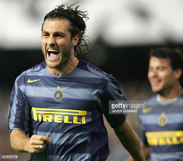 Inter Milan's Christian Vieri celebrates after scoring their second goal against Valencia during their Champions League Group G football match at the...