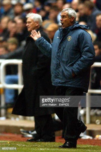 Inter Milan's coach Hector Cuper urges on his team as Newcastle United's manager Sir Bobby Robson watches in disbelief
