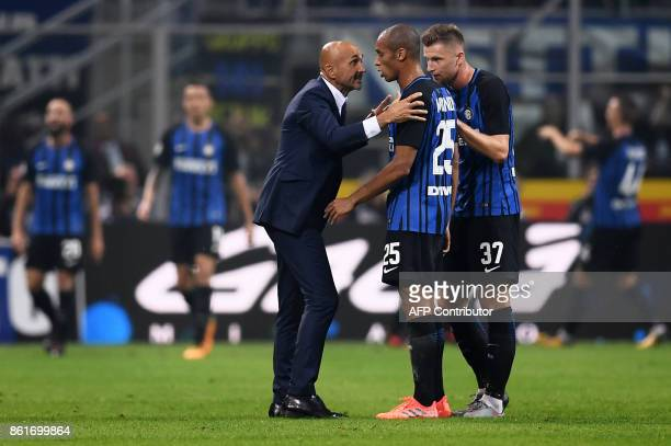 Inter Milan's coach Luciano Spalletti from Italy chats with Inter Milan's defender Joao Miranda de Souza Filho from Brazil and Inter Milan's defender...