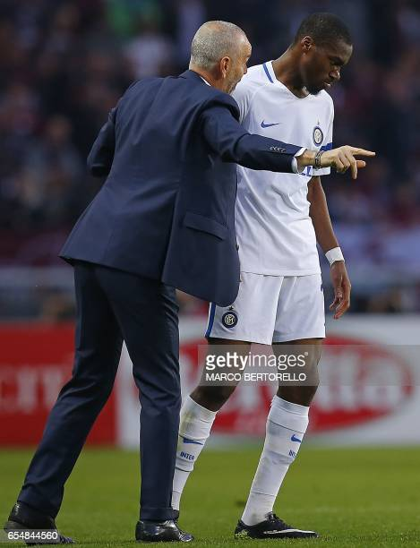 Inter Milan's coach Stefano Pioli speaks to Inter Milan's French midfielder Geoffrey Kondogbia after scoring a goal during the Italian Serie A...