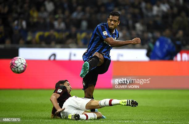 Inter Milan's Colombian midfielder Fredy Guarin kicks the ball to score a goal during the Serie A football match between Inter Milan and AC Milan at...