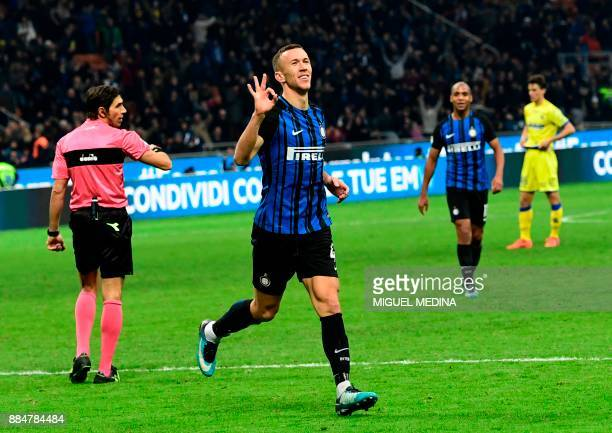 Inter Milan's Croatian forward Ivan Perisic celebrates after scoring during the Italian Serie A football match Inter Milan vs Chievo on December 3...