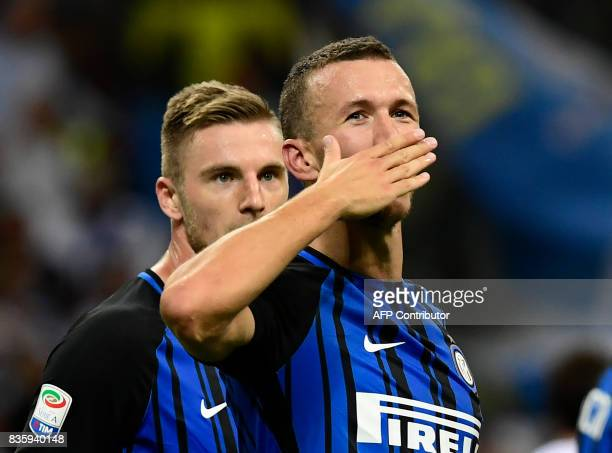 Inter Milan's Croatian forward Ivan Perisic gestures after scoring a goal during the Italian Serie A football match Inter Milan vs Fiorentina at the...