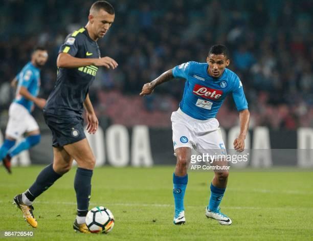 Inter Milan's Croatian midfielder Ivan Perisic controls the ball next to Napoli's Brazilian midfielder Allan during the Italian Serie A football...