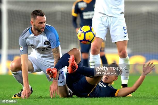 Inter Milan's Croatian midfielder Marcelo Brozovic vies with Hellas Verona's South Korean midfielder Lee SungWoo during the Italian Serie A football...