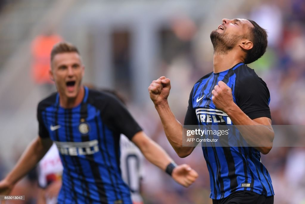 Inter Milan's defender Danilo D'Ambrosio celebrates after scoring during the Italian Serie A football match Inter Milan Vs Genoa on September 24, 2017 at the San Siro stadium in Milan. /