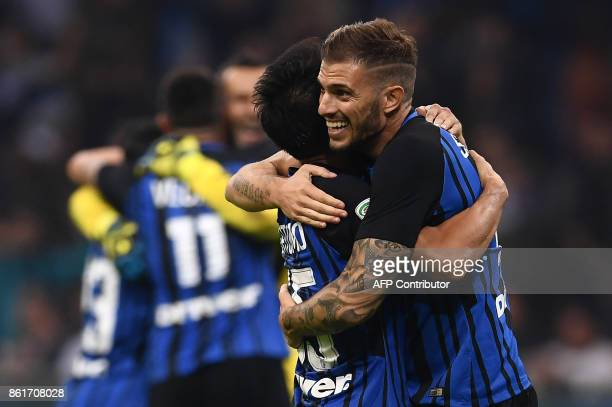 Inter Milan's defender Davide Santon from Italy celebrates with Inter Milan's defender Yuto Nagatomo of Japan at the end of the Italian Serie A...