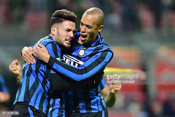 Inter Milan's defender from Italy Danilo D'Ambrosio celebrates after scores a goal with Inter Milan's defender from Brazil Joao Miranda during the...