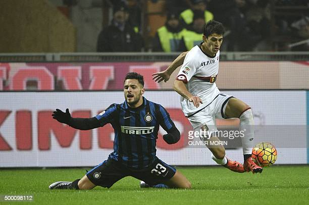 Inter Milan's defender from Italy Danilo D'Ambrosio fights for the ball with Genoa's defender from Italy Armando Izzo during the Italian Serie A...
