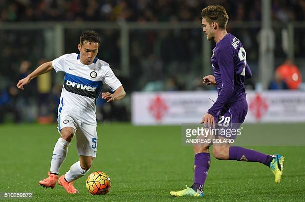 Inter Milan's defender from Japan Yuto Nagatomo fights for the ball with Fiorentina's defender from Spain Marcos Alonso Mendoza during the Italian...