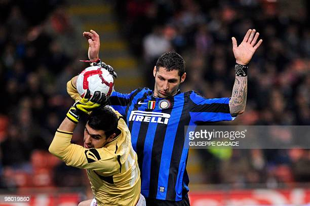 Inter Milan's defender Marco Materazzi vies for the ball with Livorno goalkeeper Rubinho during their Series A football match Inter Milan vs Livorno...
