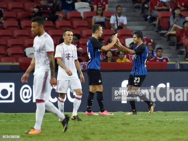 Inter Milan's Eder celebrates with teammate Ivan Perisic after his second goal against Bayern Munich during their International Champions Cup...