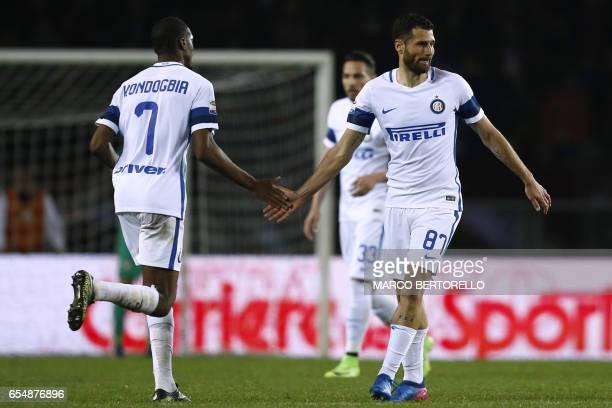 Inter Milan's forward Antonio Candreva celebrates after scoring with Inter Milan's French midfielder Geoffrey Kondogbia during the Italian Serie A...