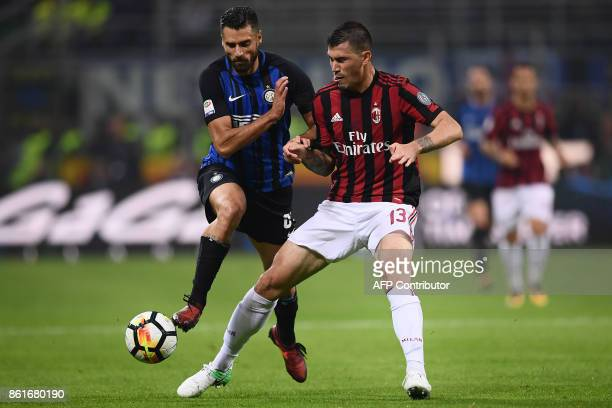 Inter Milan's forward Antonio Candreva from Italy fights for the ball with AC Milan's defender Alessio Romagnoli during the Italian Serie A football...