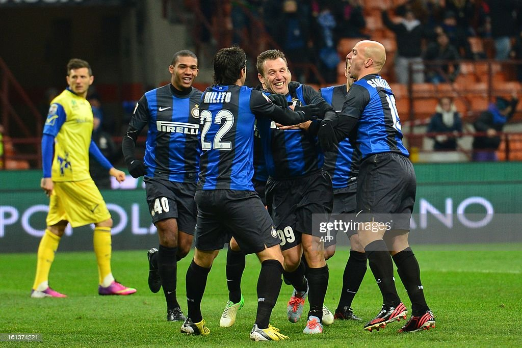 Inter Milan's forward Antonio Cassano (L) celebrates with team mates after scoring a goal during an Italian Serie A football match between Inter Milan and Chievo at San Siro Stadium in Milan on February 10, 2013. AFP PHOTO / GIUSEPPE CACACE