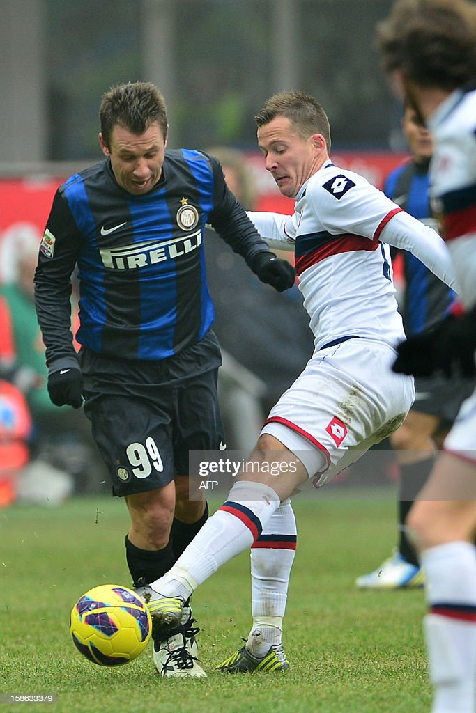 Inter Milan's forward Antonio Cassano (L) fights for the ball with Genoa's Hungarian midfielder Daniel Tozser during their the Serie A football match between Inter Milan and Genoa at San Siro Stadium in Milan on December 22, 2012.