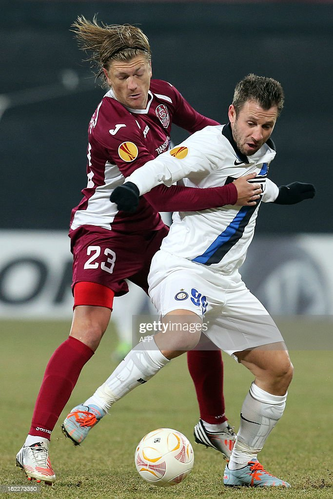 Inter Milan's forward Antonio Cassano (R) vies for the ball with Cluj's French midfielder Nicolas Godemeche during the UEFA Europa League Round of 32 football match CFR 1907 Cluj vs Inter Milan in Cluj, northern Romania on February 21, 2013.