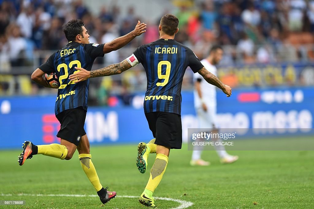 Inter Milan's forward from Argentina Mauro Icardi celebrates after scoring a goal with Inter Milan's midfielder from Argentina Ever Banega during the...