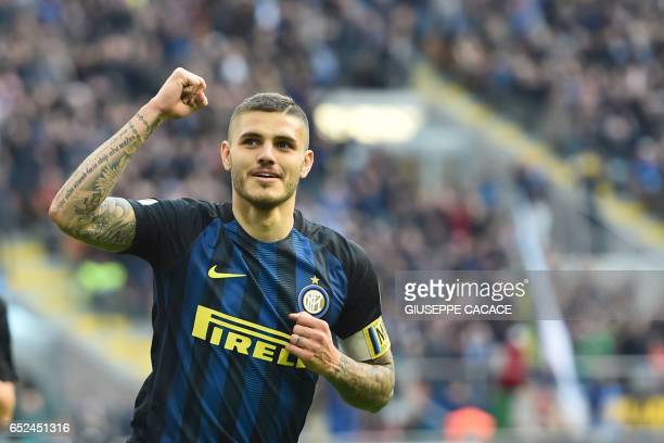 Inter Milan's forward from Argentina Mauro Icardi celebrates after scoring a penalty during the Italian Serie A football match Inter Milan vs...