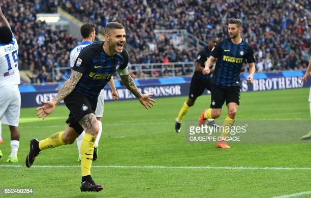 Inter Milan's forward from Argentina Mauro Icardi celebrates after scoring during the Italian Serie A football match Inter Milan vs Atalanta at 'San...