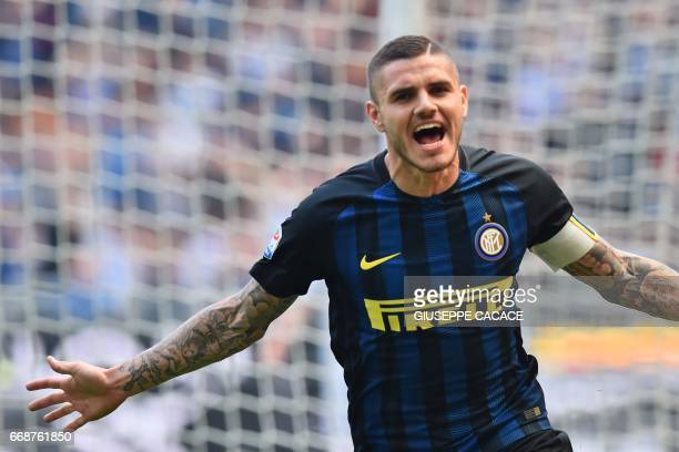 Inter Milan's forward from Argentina Mauro Icardi celebrates after scoring during the Italian Serie A football match Inter Milan vs AC Milan at the...
