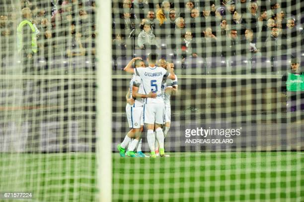 Inter Milan's forward from Argentina Mauro Icardi celebrates with teammates after scoring during the Italian Serie A football match Fiorentina vs...