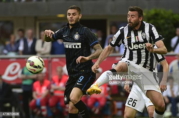 Inter Milan's forward from Argentina Mauro Icardi fights for the ball with Juventus' defender Andrea Barzagli during the Italian Serie A football...