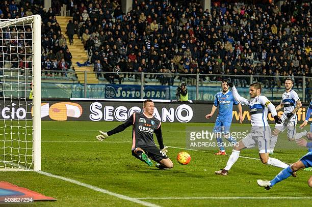 Inter Milan's forward from Argentina Mauro Icardi scores against Empoli's goalkeeper from Poland Lukasz Skorupski during the Italian Serie A football...