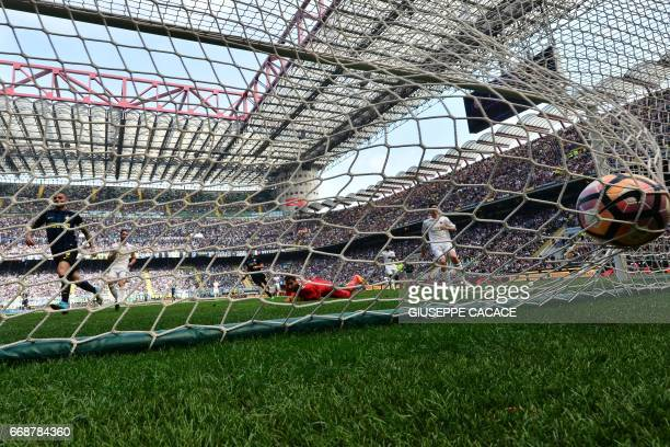 Inter Milan's forward from Argentina Mauro Icardi scores during the Italian Serie A football match Inter Milan vs AC Milan at 'San Siro' Stadium in...