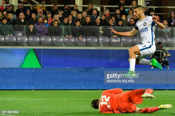 Inter Milan's forward from Italy Antonio Candreva jumps above Fiorentina's goalkeeper from Romania Ciprian Anton Tatarusanu during the Italian Serie...