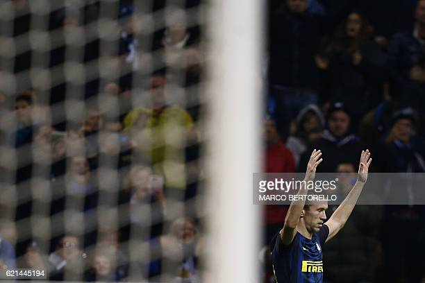 Inter Milan's forward Ivan Perisic from Croatia celebrates after scoring during the Italian Serie A football match Inter Milan Vs Crotone on November...