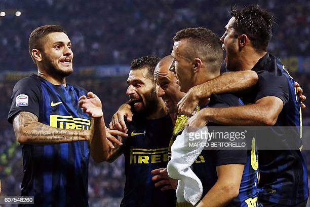 Inter Milan's forward Ivan Perisic from Croatia celebrates after scoring with Inter Milan's forward Mauro Emanuel Icardi from Argentina during the...