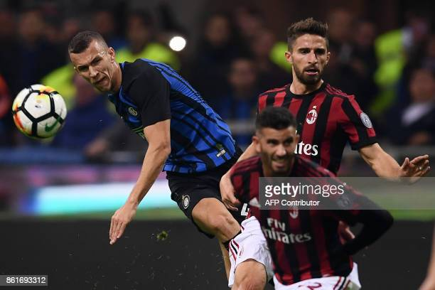 Inter Milan's forward Ivan Perisic from Croatia fights for the ball with AC Milan's forward Fabio Borini from Italy during the Italian Serie A...