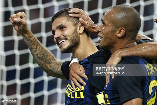Inter Milan's forward Mauro Emanuel Icardi from Argentina celebrates after scoring with his teammate during the Italian Serie A football match Inter...