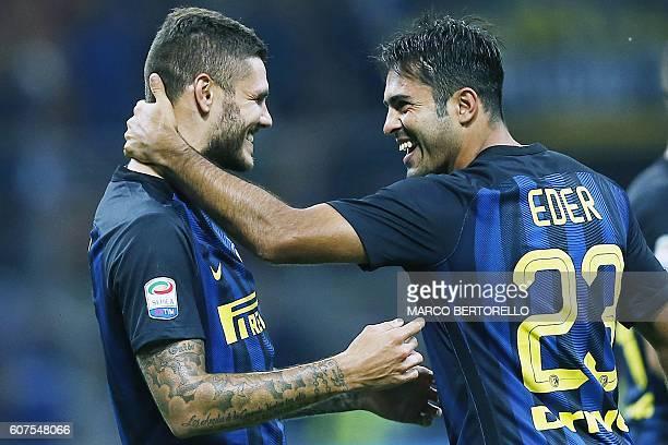 Inter Milan's forward Mauro Emanuel Icardi from Argentina celebrates with Inter Milan's forward Citadin Martins Eder during the Italian Serie A...