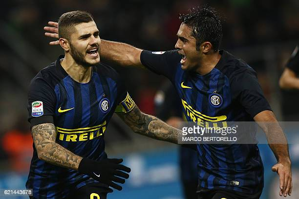 Inter Milan's forward Mauro Emanuel Icardi from Argentina celebrates with teammates after scoring during the Italian Serie A football match Inter...