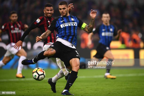 Inter Milan's forward Mauro Emanuel Icardi scores during the Italian Serie A football match Inter Milan Vs AC Milan on October 15 2017 at the 'San...