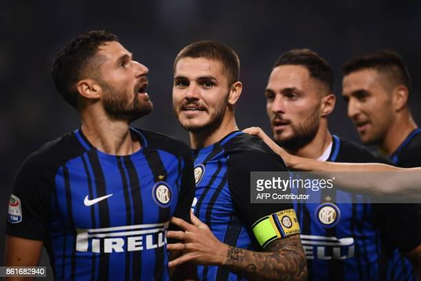 Inter Milan's forward Mauro Icardi from Argentina celebrates with teammates after scoring during the Italian Serie A football match Inter Milan Vs AC...