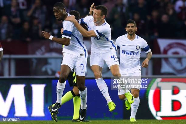 Inter Milan's French midfielder Geoffrey Kondogbia celebrates after scoring during the Italian Serie A football match Torino vs Inter Milan on March...