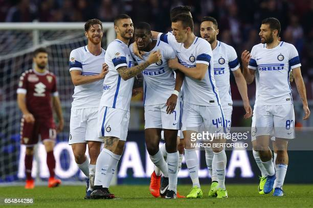 Inter Milan's French midfielder Geoffrey Kondogbia celebrates with teammates after scoring during the Italian Serie A football match Torino versus...