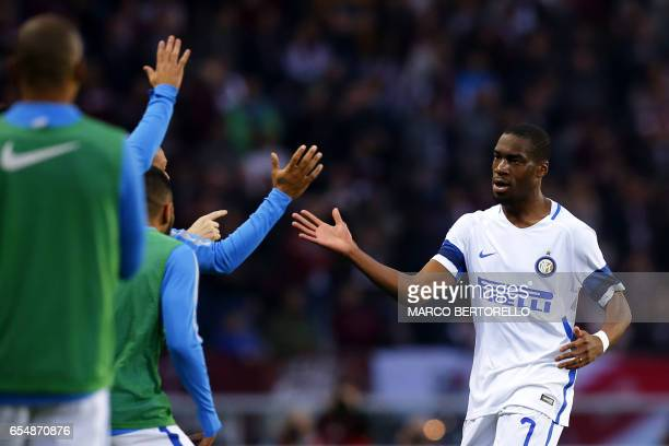 Inter Milan's French midfielder Geoffrey Kondogbia celebrates with teammates after scoring a goal during the Italian Serie A football match Torino...