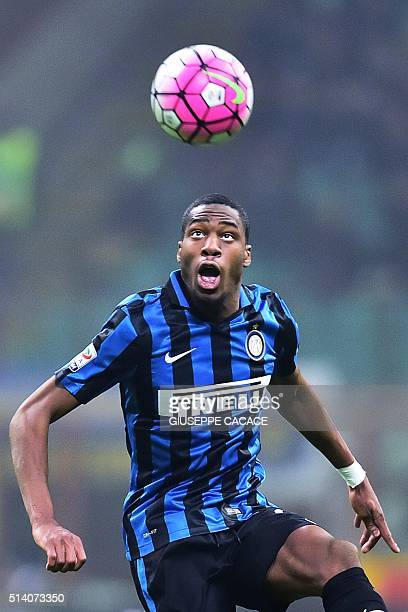 Inter Milan's French midfielder Geoffrey Kondogbia jumps for the ball during Italian Serie A football match between Inter Milan and Palermo at the...